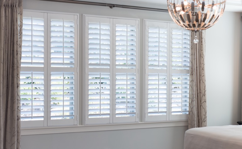 Austin plantation shutters master bedroom
